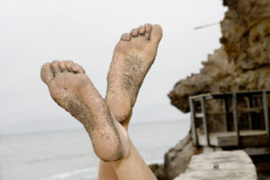 Woman's Feet Covered with Sand