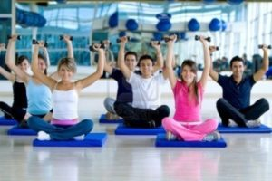 6476491-group-of-people-at-the-gym-exercising-with-free-weights_518aaa659606ee7c05035f76