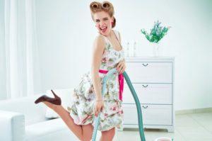 Retro-housewife-vacuuming-a-floor-2201727