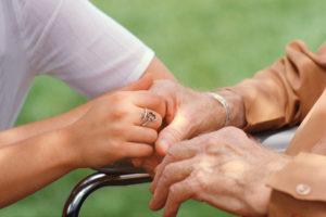 Nurse Holding Elderly Patient's Hand