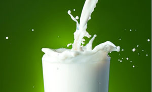 Filling the glass with milk